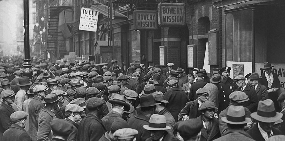 Crowds of unemployed men outside the Bowery Mission on the Lower East Side, Manhattan, New York City, USA, circa 1935. The mission provides food, assistance and a labour bureau for the unemployed and destitute. (Photo by Keystone View Company/Archive Photos/Getty Images)